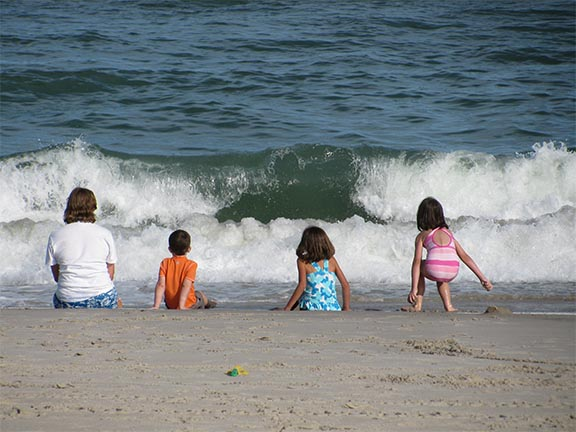 Children looking at waves 144
